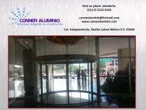 Foto de CONNER Aluminio Cancelería Cristal Ventanas Baños Domos Portones Automatizaciones